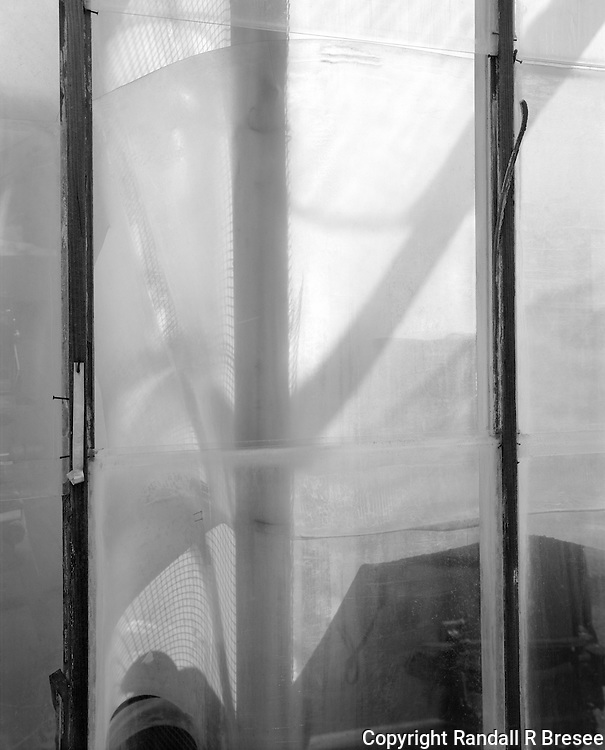 &quot;Greenhouse Clutter&quot; Gibson Greenhouses, Maryville, Tennessee<br /> <br /> This black &amp; white photograph shows a little clutter resting quietly in a greenhouse.
