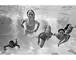 Girls Swimming Underwater