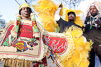 A member of the Red Hawk Mardi Gras Indians walks through the crowd downtown in New Orleans on Mardi Gras day, February 16, 2010.