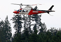 Aug. 3, 2013; Kent, WA, USA: A medivac rescue helicopter takes off from NHRA qualifying for the Northwest Nationals at Pacific Raceways. Mandatory Credit: Mark J. Rebilas-USA TODAY Sports