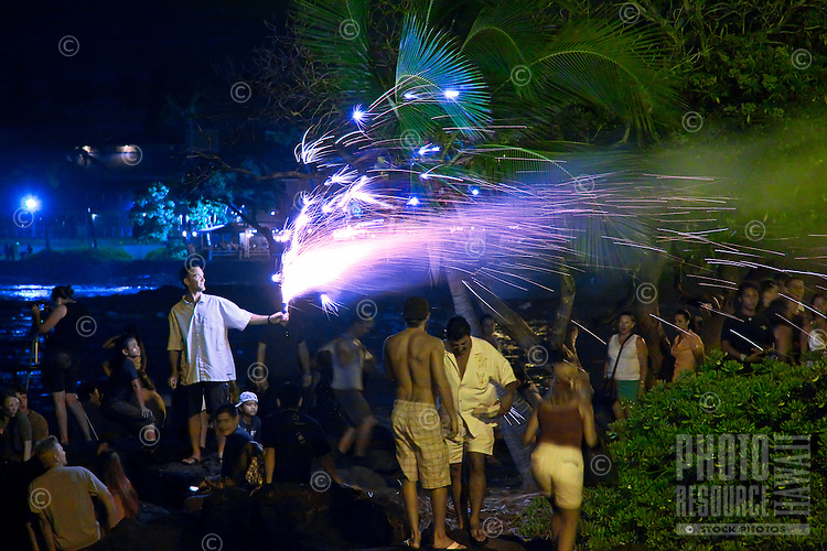 People enjoying fireworks on the Fourth of July - Independence Day, Kailua Bay, Kailua Kona, Big Island.