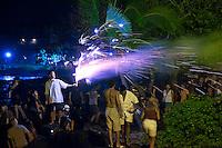 People enjoying fireworks on the Fourth of July - Independence Day, Kailua Bay, Kailua Kona, Big Island.