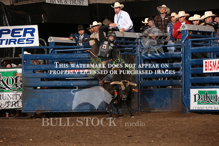 Derek Kolbaba attempts to ride Dakota Rodeo/chad Berger/Clay Struve/Ken Barnhard's Modified Clyde during the Championship round of the Bismarck Real Time Pain Relief Velocity tour PBR. Photo by Andy Watson