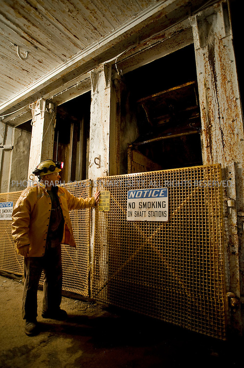 3/20/2008--Big Creek, ID, USA..At the end of a shift, Dan Clark exits the Jewell Shaft at the Sunshine Mine in Idaho. With the price of silver climbing, Idaho's once struggling silver mining industry is making a comeback...Sunshine Mine is situated in the Coeur d'Alene Mining District of North Idaho at Big Creek, 8 miles southeast of Kellogg, Shoshone County, Idaho. The mine has produced more than 365 million ounces from 1884 until its closure in early 2001. It was discovered and initially mined on a small-scale by True and Dennis Blake, and then passed into corporate hands after their deaths in the early 1900s. Sunshine Mining Company owned and operated the mine in subsequent decades and produced silver from at least 7 vein systems. Two of these vein systems, Sunshine and Chester, have each produced more than 100 million ounces of silver to date. The mine closed in 2001 because of low silver prices...Sterling Mining Company acquired the rights to the Sunshine Mine in 2003 and has reopened the mine, hiring local residents to come back to mine...©2008 Stuart Isett. All rights reserved.