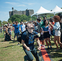 """White teens do ska dancing at the AfroPunk Festival in Commodore Barry Park in Brooklyn in New York on Sunday, August 26, 2012. The festival in the neighborhood of Fort Greene bills itself as the """"other black experience"""" and blends the black punk and hardcore punk scenes. There is also a diverse aspect combining other minority groups, all dressed in their fashionable punk ensembles. (© Richard B. Levine)"""