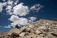 Backpacking in the Sierra Mountains west of Independence, Calif. A hiker rests at the top of Kearsarge Pass.