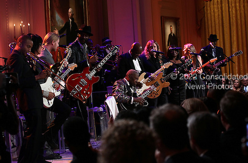 "Blues legend B.B. King performs with an all-star cast at a White House event titled In Performance at the White House: Red, White and Blues, February 21, 2012 in Washington, DC.  As part of the In Perfomance series, music legends and contemporary major artists have been invited to perform at  the White House for a celebration of Blues music and in recognition of Black History Month. The program featured performances by Troy ""Trombone Shorty"" Andrews, Jeff Beck, Gary Clark, Jr., Shemekia Copeland, Buddy Guy, Warren Haynes, Mick Jagger, Keb Mo, Susan Tedeschi and Derek Trucks, with Taraji P. Henson as the program host and Booker T. Jones as music director and band leader. .Credit: Win McNamee / Pool via CNP"