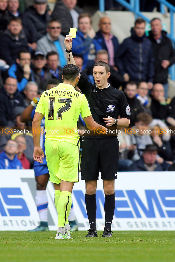 Referee Ben Toner, is in his first season on the Football League National Panel, books Southend's Stephen McLaughlin. In total he issued seven yellow cards during Gillingham vs Southend United, Sky Bet League 1 Football at the MEMS Priestfield Stadium, Gillingham, England on 24/10/2015
