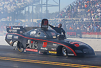 Mar. 16, 2013; Gainesville, FL, USA; NHRA crew member opens the roof hatch for funny car driver Blake Alexander during qualifying for the Gatornationals at Auto-Plus Raceway at Gainesville. Mandatory Credit: Mark J. Rebilas-