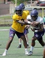 NWA Democrat-Gazette/DAVID GOTTSCHALK Fayetteville High School quarterback Darius Bowers runs an offensive play Monday, May 14, 2018 at Harmon Stadium in Fayetteville.