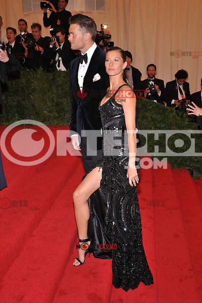 Tom Brady and Gisele Bundchen at the 'Schiaparelli And Prada: Impossible Conversations' Costume Institute Gala at the Metropolitan Museum of Art on May 7, 2012 in New York City. ©mpi03/MediaPunch Inc.