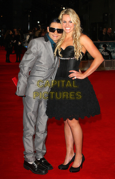 Corey Feldman & Chemmy Alcott.World Premiere of 'Woman in Black' at the Royal Festival Hall, London, England..January 24th 2012.full length black dress corset frills hand on hip grey gray suit sunglasses shades leaning.CAP/ROS.©Steve Ross/Capital Pictures