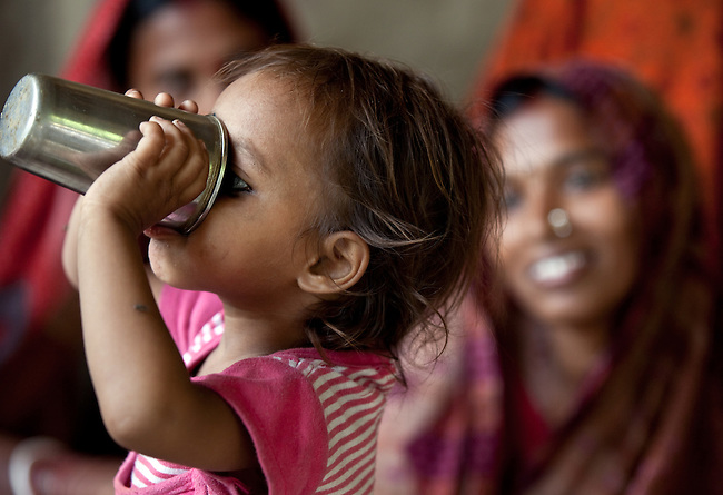 Kajal Kumari  drinks a cup of salts  during a treatment of oral rehydration salts and zinc tablets at a Anganwadi health centre in Pakauli village.The village located in Vaishali district outside Patna in Bihar, India has been rolling out the ORS and Zinc program as part of the IKEA Social Initiative to combat child mortality rates caused by diarrhea. It is proving to be very successful with education and support provided by local nursing staff, health activists  and program officers from UNICEF. The treatment is a 14 day course administering diluted oral rehydration salts and a zinc tablet which is more effective than salts alone in combating the effects of severe diarrhea. Picture by Graham Crouch/UNICEF