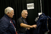 Flushing, NY - 22 August 2005 - Umpires Stuart Hicks Jr. (L) and Gerry Heckman search for uniform jackets that fit them at the National Tennis Center in Flushing, Queens, NY, USA, during preparations for the 2005 US Open, 22 August 2005.