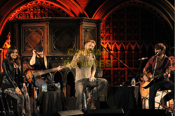 Hillary Scott, Charles Kelley, Dave Haywood of Lady Antebellum.Perform Live in concert at the Union Chapel, London, England, UK, 7th October 2011..full 3/4  length music concert gig on stage country group band black sitting leather jacket grey gray top stools playing guitar .CAP/MAR.© Martin Harris/Capital Pictures.