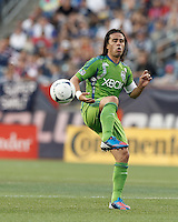 Seattle Sounders FC midfielder Mauro Rosales (10) redirects hard clear after a corner kick. In a Major League Soccer (MLS) match, the New England Revolution tied the Seattle Sounders FC, 2-2, at Gillette Stadium on June 30, 2012.
