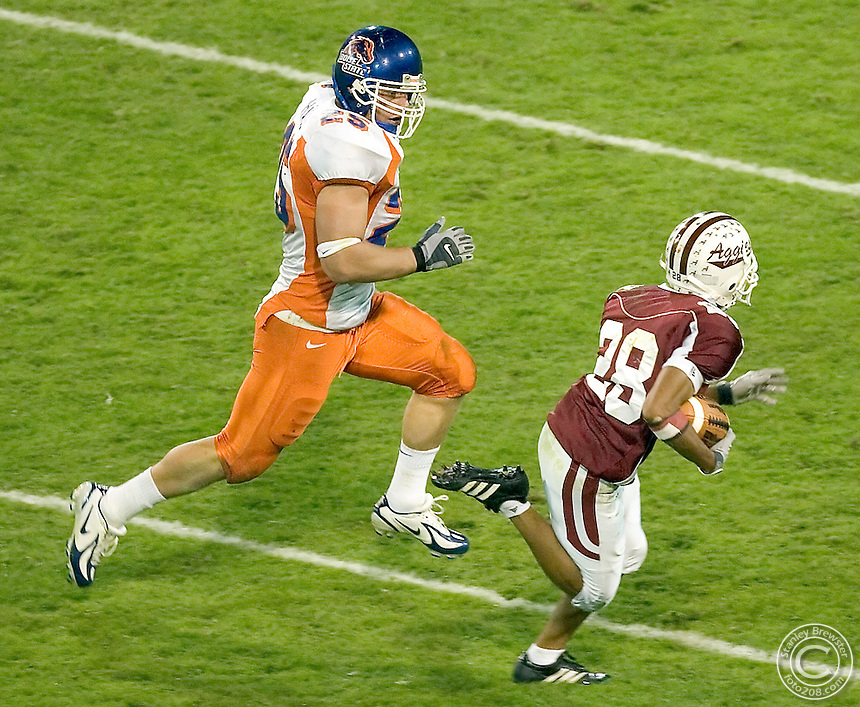 15 October 2006: Boise State linebacker runs down Aggie wide reciever Chris Williams during second half action in Memorial Stadium in Las Cruces new Mexico.
