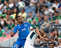 DENVER, CO - JUNE 19: Stephane Abaul #20 heads the ball during a game between Martinique and Cuba at Broncos Stadium on June 19, 2019 in Denver, Colorado.