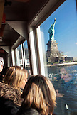 USA, New York, tourists taking a boat tour to visit the Statue of Liberty National Monument and Ellis Island