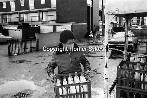 Hoxton east London young boys helps do a 'milk round'. <br />