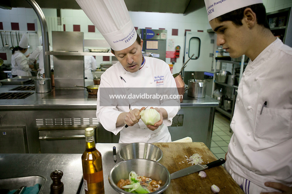 Chef Eric Robert (L) prepares ingredients as a student looks on at the start of a class at the Ecole Superieure de Cuisine Francaise Gregoire Ferrandi cooking school in Paris, France, 18 December 2007.