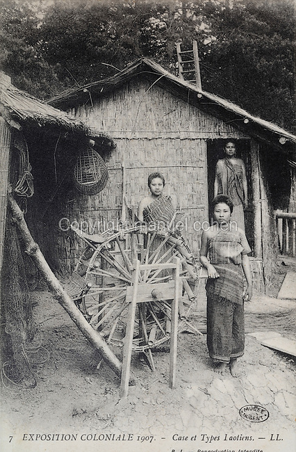 Laotian people and a traditional hut and waterwheel in the Indochinese Village (French Indochina was a colony 1887-1954), at the Colonial Exhibition of 1907, held in the Jardin d'Agronomie Tropicale, or Garden of Tropical Agronomy, in the Bois de Vincennes in the 12th arrondissement of Paris, postcard from the nearby Musee de Nogent sur Marne, France. The garden was first established in 1899 to conduct agronomical experiments on plants of French colonies. In 1907 it was the site of the Colonial Exhibition and many pavilions were built or relocated here. The garden has since become neglected and many structures overgrown, damaged or destroyed, with most of the tropical vegetation disappeared. The site is listed as a historic monument. Picture by Manuel Cohen / Musee de Nogent sur Marne
