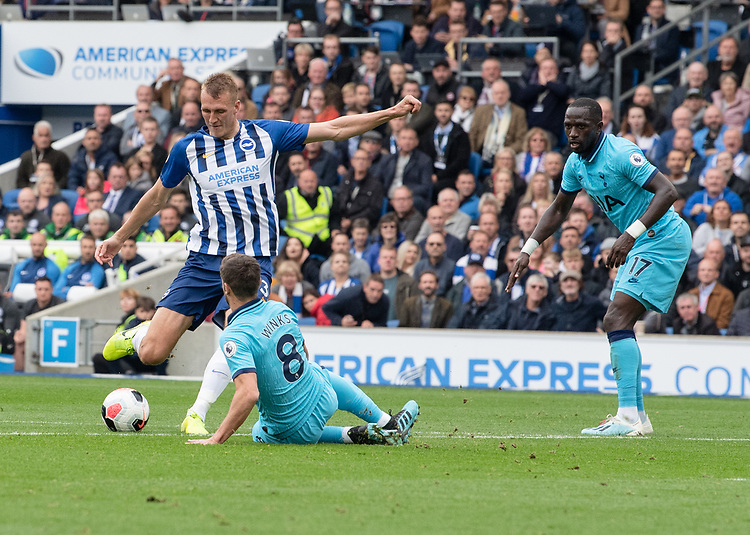 Tottenham Hotspur's Harry Winks (centre) ties to vie for possession with Brighton & Hove Albion's Dan Burn (left) <br /> <br /> Photographer David Horton/CameraSport<br /> <br /> The Premier League - Brighton and Hove Albion v Tottenham Hotspur - Saturday 5th October 2019 - The Amex Stadium - Brighton<br /> <br /> World Copyright © 2019 CameraSport. All rights reserved. 43 Linden Ave. Countesthorpe. Leicester. England. LE8 5PG - Tel: +44 (0) 116 277 4147 - admin@camerasport.com - www.camerasport.com