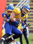 BROOKINGS, SD - APRIL 26:  Connor Landberg #18 from South Dakota State's offense is brought down by Ezekiel Herndon #21 from the defense during their spring game Saturday at Coughlin Alumni Stadium in Brookings. (Photo by Dave Eggen/Inertia)