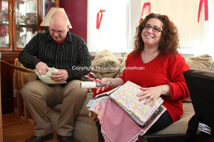 WATERBURY, CT-27 December 2013-122713LW01 - Greg Artman, left, and Julianne Artman sew pillows for cancer patients Dec. 27 in their Waterbury home.<br /> Laraine Weschler Republican-American