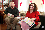 WATERBURY, CT-27 December 2013-122713LW01 - Greg Artman, left, and Julianne Artman sew pillows for cancer patients Dec. 27 in their Waterbury home.<br />