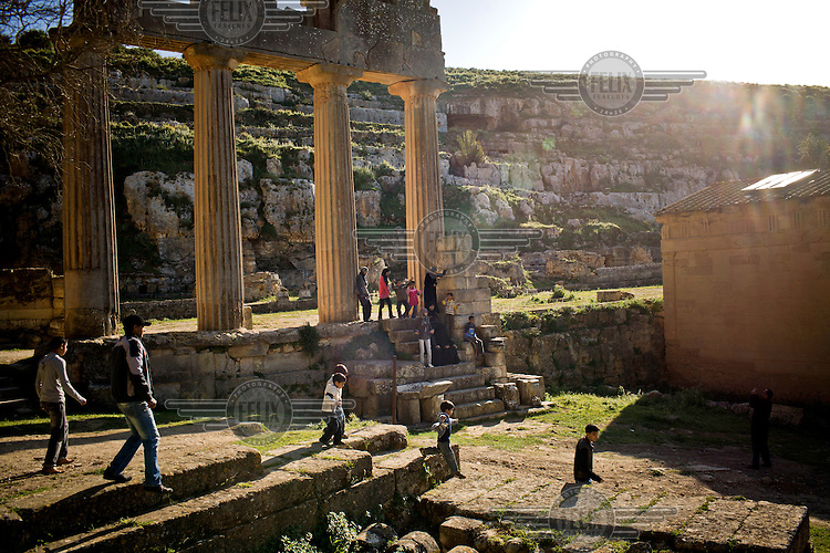Tourists visit the ancient Greek ruins of Cyrene near Al Bayda.