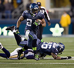 Seattle Seahawks running back Marshawn Lynch follows his blocks as runs against the St. Louis Rams at  CenturyLink Field in Seattle, Washington on December 12, 2011. The Seahawks beat the Rams 30-13. ©2011 Jim Bryant Photo. All Rights Reserved.