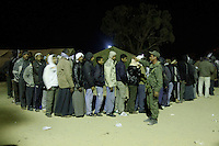 Tens of thousands of people, mainly Egyptian workers, fled unrest in Libya and crossed the border into Tunisia. Some slept in the open for several days before being processed.  At the same time forces loyal to Col. Gaddafi fought opposition forces in various parts of the country.
