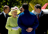 """Queen Elizabeth II speaks with STS-116 astronaut Nicholas Patrick, back to camera, as NASA Administrator Michael Griffin, right, looks on at the NASA Goddard Space Flight Center, Wednesday, May 8, 2007, in Greenbelt, Md. The Royal couple's appearance was one of the last stops on a six-day visit to the United States. Photo Credit """"NASA/Paul E. Alers"""""""