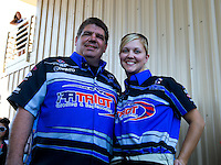 Jul. 20, 2014; Morrison, CO, USA; NHRA funny car driver Terry Haddock (left) with wife, top fuel driver Jenna Haddock during the Mile High Nationals at Bandimere Speedway. Mandatory Credit: Mark J. Rebilas-