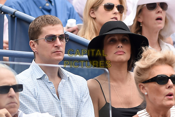 FLUSHING NY- AUGUST 30:  Matchbox Twenty front man Rob Thomas and his wife Marisol at the 2014 US Open on August 30, 2014 in Flushing Queens. <br /> CAP/MPI/MPI04<br /> &copy;MPI04/MPI/Capital Pictures