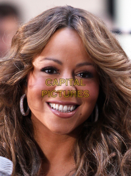 "MARIAH CAREY .performs live on NBC's ""TODAY Show"", New York, NY, USA, .2nd October 2009..concert music gig on stage performing portrait headshot smiling  curly wavy hair .CAP/ADM/PZ.©Paul Zimmerman/Admedia/Capital Pictures"