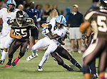 Torrance, CA 10/02/15 - Dayshawn Littleton (Carson #2) and Michael Timmerman (West #21) and Ryan Shoda (West #55) in action during the Carson-West Torrance CIF varsity football game at West Torrance High School.  Carson defeated West Torrance 34-27.