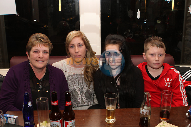 Noreen, Sarah and Rebecca Reynolds with Aaron Reilly in Barocco on Christmas Eve...Photo NEWSFILE/Jenny Matthews..(Photo credit should read Jenny Matthews/NEWSFILE)