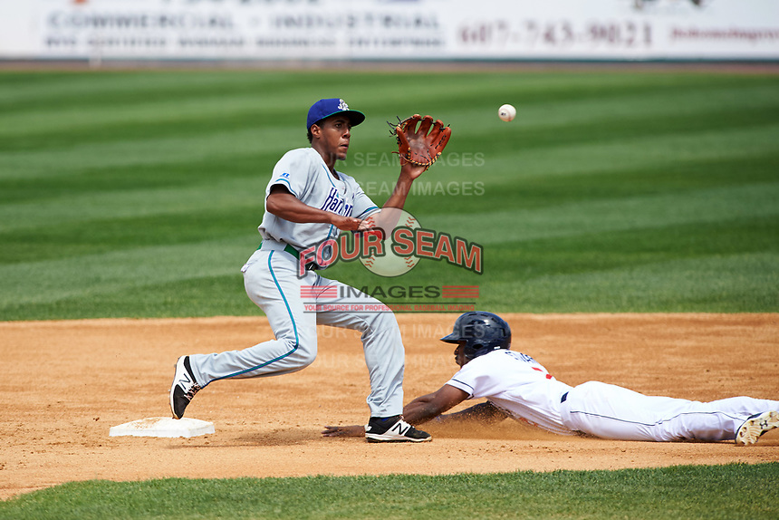 Hartford Yard Goats shortstop Luis Jean (17) stretches for a throw as Champ Stuart (5) steals second base during a game against the Binghamton Rumble Ponies on July 9, 2017 at NYSEG Stadium in Binghamton, New York.  Hartford defeated Binghamton 7-3.  (Mike Janes/Four Seam Images)