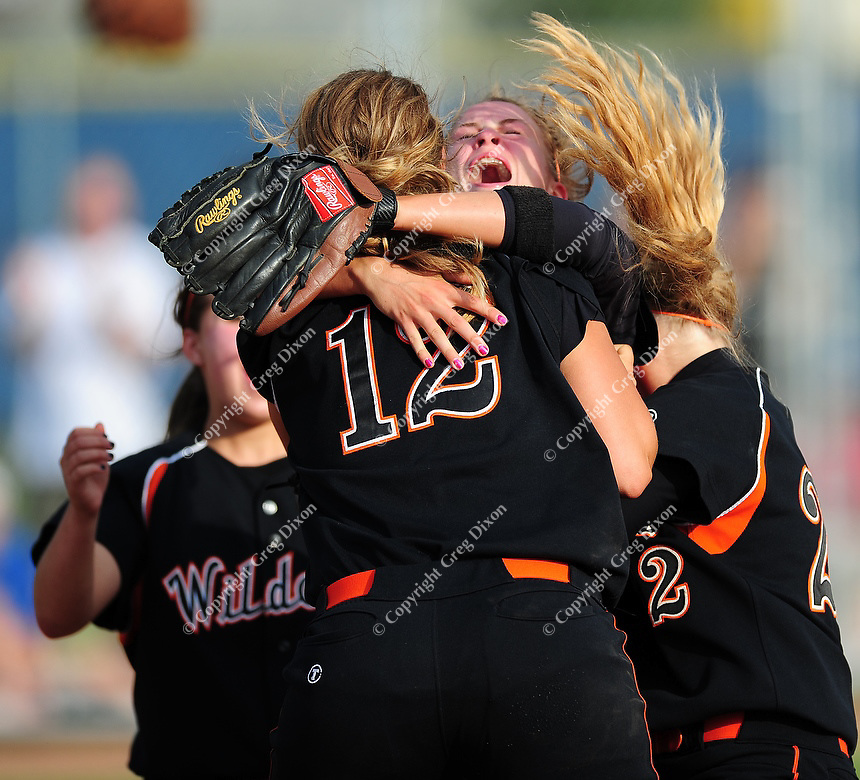 Zoe Slattery (#12) celebrates with Kirsten Brose and the rest of the Wildcats as Verona Area High School tops La Crosse Central 2-0 in Division 1 softball semifinals at Firefighters Park in Middleton, Wisconsin on Friday, 6/11/10