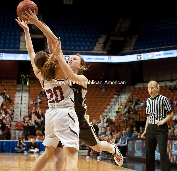 UNCASVILLE,  CT,  CT-032115JS13-Canton's Jacquie Grabowski (20) is fouled by Thomaston's Gabby Hurlbert (11) while going for the ball during the Class S state championship Saturday at the Mohegan Sun Arena. <br />  Jim Shannon Republican-American
