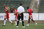 15 July 2007: Chicago head coach Juan Carlos Osorio (COL) (in white) watches his players warm up.  The United Soccer League Division 1 Carolina Railhawks defeated Major League Soccer's Chicago Fire 1-0 in a Third Round Lamar Hunt U.S. Open Cup game at SAS Stadium in Cary, North Carolina.