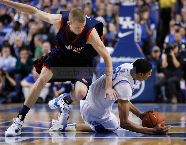 UK's Anthony Davis battles for the ball at the half-court against Samford at Rupp Arena on Tuesday, Dec. 20, 2011. Photo by Scott Hannigan | Staff