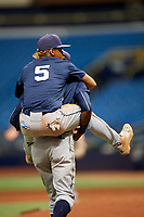 Osmy Gregorio (22) carries Jelfry Marte (5) during the Tampa Bay Rays Instructional League Intrasquad World Series game on October 3, 2018 at the Tropicana Field in St. Petersburg, Florida.  (Mike Janes/Four Seam Images)