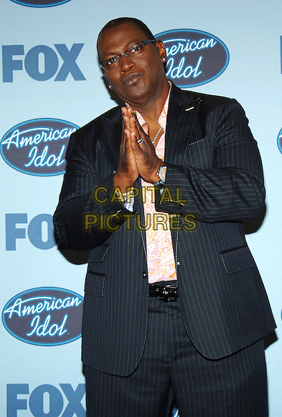 "RANDY JACKSON.""American Idol"" Season 4 Finale held at The Kodak Theatre..May 25th, 2005.Photo Credit: Jacqui Wong/AdMedia.half length praying hands together gesture black pinstripe jacket.www.capitalpictures.com.sales@capitalpictures.com.© Capital Pictures."