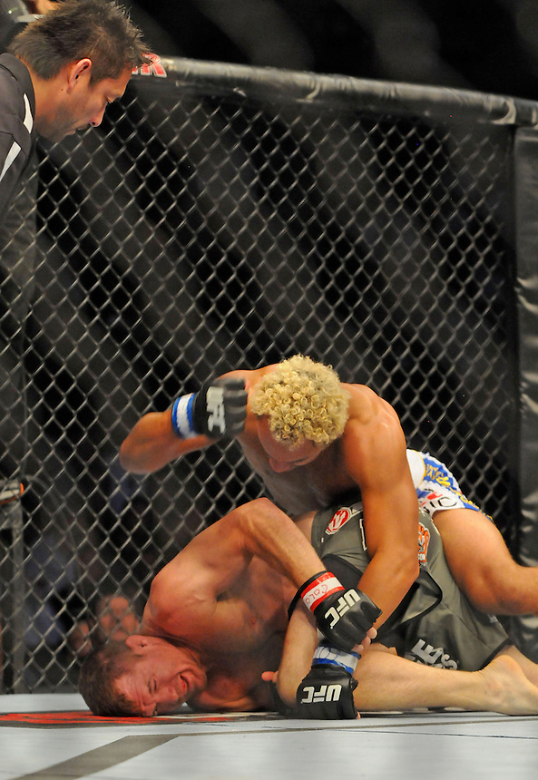 24 SEPTEMBER 2011:   Josh Koscheck lands the final set of blows on Matt Hughes  during UFC 135 at the Pepsi Center in Denver, Colorado. *****For Editorial Use Only*****