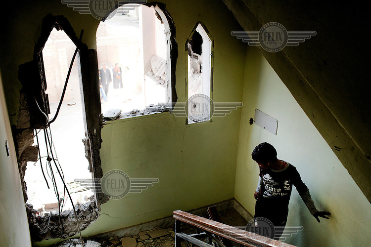 A young boy stands on the stairs of his house that was partly destroyed by a missile fired by pro-Gadaffi forces. According to the family living in there no rebels were fighting from the house and residents accused the pro-Gadaffi forces of indiscriminate firing at residential property. On 17 February 2011, an uprising against the 41 year rule of Col. Muammar Gadaffi started in eastern Libya.