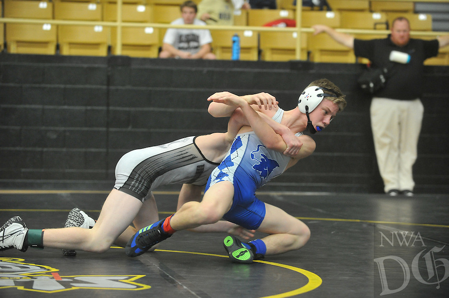NWA Democrat-Gazette/MICHAEL WOODS &bull; <br /> Stephen Fox from Bentonville High School, (grey jersey) and Ben Bickle from Rogers High, compete Saturday, December 19, 2015 in the championship match in the 113 pound division at the Bentonville High School wrestling tournament.
