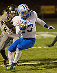 Galena #3 Travis Bohal, grabs McQueen's #23 Tyler Hutton during their Northern Division I playoff football game played on Friday night, November 6, 2015 at Galena High School in Reno, Nevada.